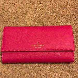 Kate spade wallet and magnetic iPhone 7 case.
